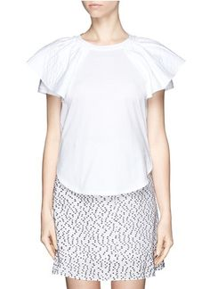 The basic tee is given an affectionate update in this white Chloé top fitted with wing-like sleeves. Made with a ruffle cape sleeve overlay, shoulders are accentuated with graceful volume for girlish flair. Pair it with a mini A-line skirt and ballet flats to complete the look.The basic tee is given an affectionate update in this white Chloé top fitted with wing-like sleeves. Made with a ruffle cape sleeve overlay, shoulders are accentuated with graceful volume for girlish flair. Pair it ...