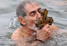A Greek Orthodox man kisses the wooden cross he retrieved from the Bosphorus river's Golden Horn as part of Epiphany celebrations in Istanbul  Picture: BULENT KILIC/AFP/Getty Images