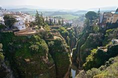 Seen here is the breathtaking city of Ronda, Spain, located in the province of Málaga. The popular tourist destination is characterized by the gorge that divides the city where the Guadalevín River runs through. The gorge is spanned by three bridges, Puente Nuevo, Puente Viejo and Puente Romano.