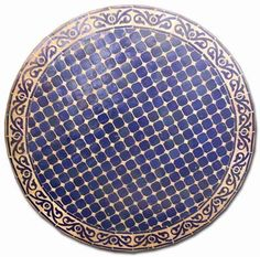 A solid large moroccan mosaic tile table, great quality, all weather tile table. This table comes with a wrought iron base. It is a great piece that will make your home decor look special and will last forever. This table measures 47