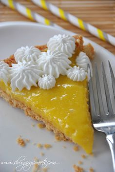 Lemon Tart with Macadamia Nut Crust: shortbread macadamia nut crust topped with homemade lemon curd and whipped cream