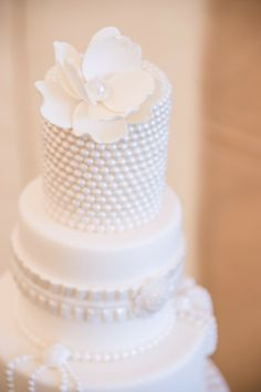 Delicate White Wedding Cake with Pearl Details by KakesbyKaren, photographed by Hunter Ryan Photo | Two Bright Lights