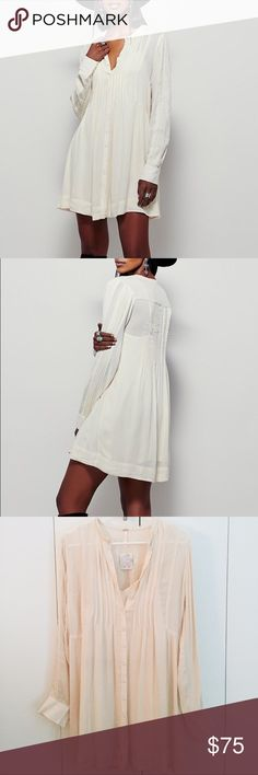 NWT Free people ivory pintuck shirt dress New with tags ivory pintuck dress by Free People. Size XS, but has a swingy, oversized fit so could easily fit size S. Looks great with boots or flats. Perfect boho dress for fall. No low ball offers, as this is a brand new item. Free People Dresses Long Sleeve