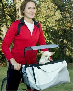 Tagalong Pet Bicycle Basket from RadioFence.com can convert to a carrier. Has side pockets and internal compartments for sunglasses, keys, etc. Additional pockets for treats, a leash or water bottle! Bracket system makes it easy to take the basket on and off in seconds with just one hand! A removable sunshade allows pets to cool off as they ride along, and the adjustable safety leash ensures pets' safety. Only $49.95 and FREE SHIPPING! (http://www.radiofence.com/tagalong-pet-bicycle-basket/)