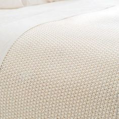 Remy is a lightweight, loose-knit cotton blanket with a homey hand-feel in a classic ivory color.