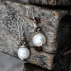 Beautiful studs with pearls and zirconia stones that are beautiful and attractive in nature with a better look on women and girls #silver #silverjewellery #pearls #pearljewellery #zirconiastones #studs #silverstuds #beautifulearrings #silverstore #pearlearrings #silverornaments #pearlstuds #earringswithpearls #stonedearrings #earringswithstone