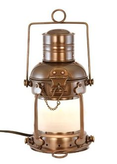 "Electric Lantern - Ships Lanterns Antique Brass Anchor Lamp - 10"" by vermontlanterns.com. $109.97. We ship daily - express shipping options available - contact us - Vermont Lanterns. Solid brass lamp stands 10"" tall. A perfect blend of form and function our lamps add to any decor, as well as being fully operational for ambient and emergency lighting. Shop our Amazon store - many more oil and electric models available. Uses 25 w standard bulb. Electric Nautical ..."
