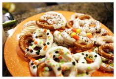 easy halloween pretzels - dipped in white chocolate, add sprinkles/candy corn