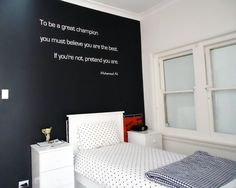 Love this one.  We did a powerful sports quote for a sports loving tweens room.  Using word mixed and one long quote for a teenage boys room.  Simple yet effective.  Designed and installed by Cool Art Design.