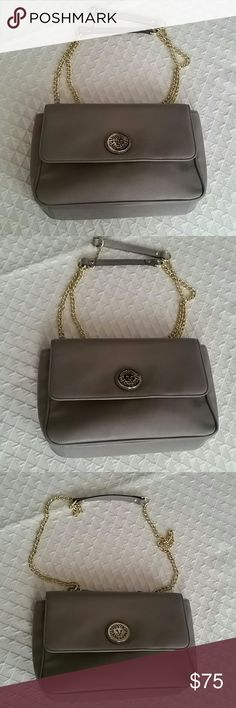 ANN KLEIN CROSSBODY/SHOULDER BAG ANN KLEIN Beautiful crossbody bag converts to shoulder bag. EUC Like new in Smoke color. Beautiful gold chain & hardware. Double chain converts to single & both have shoulder padding for comfort. Flap has snap closure. Back has large open pocket. Inside is pretty polka dots with 1 zippered pocket & 1 slip pocket.  Very Classic Bag for a very Classy Lady! Bags