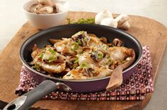 """Mushroom """"Bruschetta"""" Chicken Skillet recipe, Your husband just might think tonight's your anniversary—and he forgot—when you serve this. Chopped herbs and sprinkling of cheese add dressed-up flavor to a smart dish."""