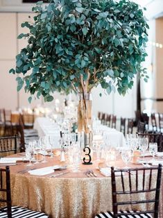 Gorgeous green and gold wedding reception decor; Featured Photographer: Honey Honey Photography, Featured Event Design: Très Chic Affairs