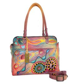730a5428588 Practicality at its finest. Revolutionary style already in HIGH demand.  This exquisite hand painted bag will fit most small laptops  notebooks and  tablets.