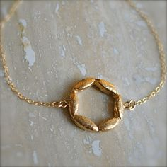 Gold Circle Bracelet  by illuminancejewelry-- What a pretty nontraditional Magen David.