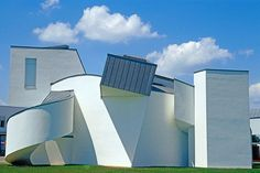 Since the early 1980s, furniture manufacturer Vitra has enlisted up-and-coming architects to create buildings for its campus in Weil am Rhein. Among them is Gehry's Vitra Design Museum, which opened in 1989. For the 8,000-square-foot venue, Gehry piled simple simple geometric forms against a cubic volume, unifying them all with white plaster surfaces and zinc roofing.