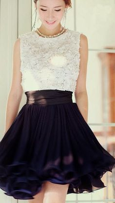 Sleeveless white pleated dress and flowy skirt
