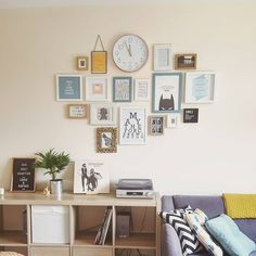 My new favourite wall in our flat. Various frames collected over the years, postcards, prints, wall art, clock from primark. Sofa from sofology, cushions from tk maxx. Living room. Wall art. Frames. Prints. Midcentury. Scandi. Mustard and grey. Mustard grey and teal. Plants. Frame wall. Kallax from Ikea.