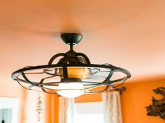 The guest bedroom's ceiling fan and light has a bronze finish that compliments the hardware in the room.