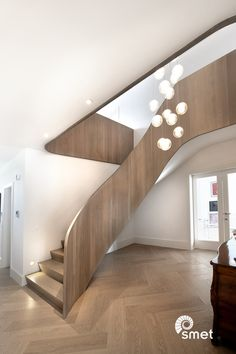 These pictures speak for themselves... The epitome of understated luxury. Serene and grand at the same time.  The Walton-on-Thames staircase really is a one of a kind staircase, where we used solid French Oak panels for the balustrade. It curves beautifully in every turn and makes a grand sweep at the start.