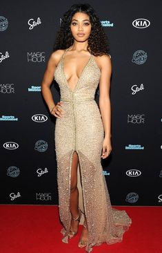 Danielle Herrington in a plunging gold lace dress