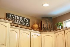 I need to decorate above my cabinets...love greenery and old signs...