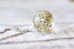 Dainty Queen Anne's Lace Resin Pendant - Resin Sphere Necklace - Real Dried Flowers In Sphere - Pressed Flower Jewelry by Resity on Etsy https://www.etsy.com/ca/listing/181148552/dainty-queen-annes-lace-resin-pendant
