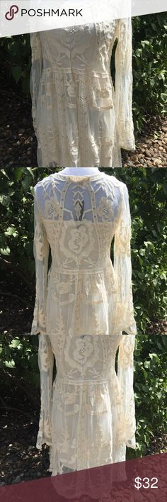 Lovely embroidered dress This is such a pretty dress. The stock photos don't show it well. It has its own slip. Very nice. You can't beat it for the price. Dresses Long Sleeve