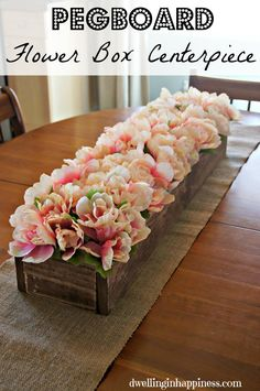 GENIUS! Use pegboard and wood to make a centerpiece. Flower stems go right into each little hole to fill it up! Perfect for weddings, parties, and any season! via @dwellinghappy