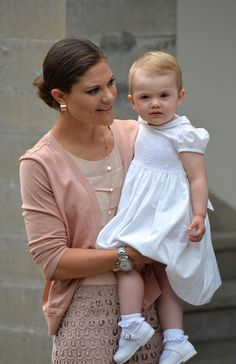 Crown Princess Victoria of Sweden and daughter Princess Estelle of Sweden attend Victoria Day celebrations at Solliden Castle on 14 July 2013 in Borgholm, Sweden