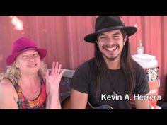 Kevin A. Herrera Shares with Marva Greenleaf at the AV Winery Farmers Ma...