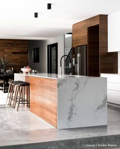 Raw concrete steps lead up to this dreamy kitchen Get started on your home improvement project at www.houzz.com.au Project:…
