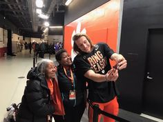 a person standing next to a building: Clemson quarterback Trevor Lawrence shares a touching moment with two fans just after winning a national title with the Tigers. (Special to Yahoo Sports) Clemson Quarterback, Clemson Football, College Football Playoff, College Quarterbacks, Football Squads, Joe Hamilton, Football Recruiting, Nick Saban, Football Highlight