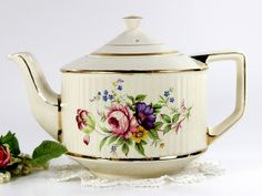 Sadler Tea Pot, Vintage Ribbed 6 Cup Teapot with Rose Motif, English Pottery. A larger pot in goodvintage condition. Clean inside and out, significant clean on both pieces. Cream, ribbed exterior. ros