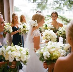 Orchids in her hair w cathedral veil and bridesmaids hair