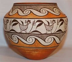 #adobegallery - Polychrome Acoma Olla with Birds by an unknown potter - This is an exceptionally fine Acoma Pueblo polychrome olla, dating from circa 1930s. Formed in native clay with ground pottery shard temper, this vessel exhibits a rag-wiped white slip, orange/red neck interior and orange/red-slipped underbody with concave base, typical of Acoma pottery. The high point of maximum diameter, design elements, execution and a shorter neck are indicative of vessels created after 1900.