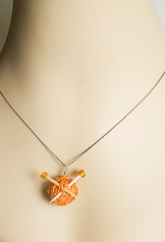 Yarn Ball Neckace .... ohhh, this is cute! I will make a bracelet with different colors and without the 'toothpicks' :))