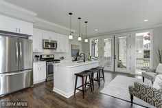 Contemporary Kitchen with Ms international bianco venatino marble, Hardwood floors, Pendant light, Built-in bookshelf
