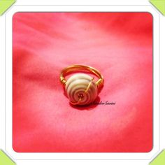 Wire wrapped Puka Shell Ring by SandeeSavini on Etsy, $7.00
