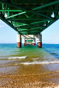 (c) Stacy K. Sheckell/Stacy K. Creations. This photo was taken under the Mackinac Bridge. On the left is Lake Michigan, on the right is Lake Huron, and across the 5 mile strait is Michigans Upper Peninsula. This point of view just goes on and on. The blues and greens of the lakes go with the vibrant green of the bridge I love.    I entered the Epiphanie Camera Bags Picture It photo contest. bit.ly/xN3Pqc