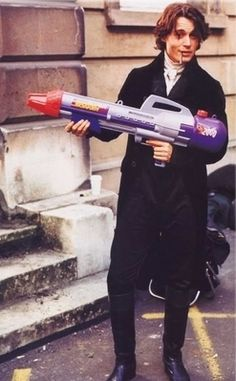 Johnny as Ichabod Crane with a water gun. Niiiice...