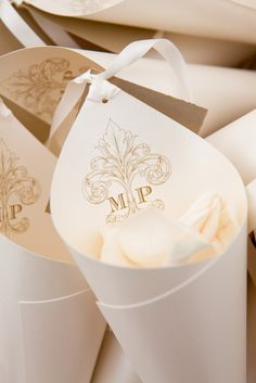 Ceremony Paper Cones with Petals for Toss | Photography: Bob & Dawn Davis Photography. Read More: http://www.insideweddings.com/weddings/oceanfront-ceremony-opulent-pink-and-metallic-reception/407/