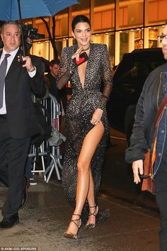 Leggy lady: Kendall turned heads in her ultra glam gown as she arrived for the star-studde...