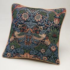 """Buy Blue Strawberry Thief Cushion from Museum Selection. Buy any two for £37.50 Smart tapestry cushion with cream piped-border, reproducing William Morris's 'Strawberry Thief' design, first printed in 1883; its subject is thought to have been inspired by watching thrushes stealing fruit at his Oxfordshire home, Kelmscott Manor.  Polyester tapestry with polyester-filled pad. 17"""" square,"""