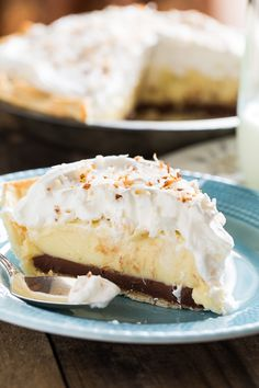 Black Bottom Coconut Cream Pie with a whipped cream topping and toasted coconut.