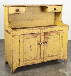 """Pennsylvania painted pine drysink, 19th c., the upper shelf with two under-hanging drawers, retaining an old yellow surface, 47.5"""" H. x 47"""" W."""