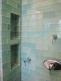 pretty glass tiles & I love the alcoves for shampoo etc