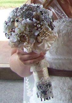 Brooch Bouquet with the handle wrapped in the lace from her mother's wedding gown.