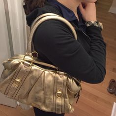 Gold leather Burberry bag 100% authentic gold leather Burberry bag...will including Burberry dust bag with purchase barely used good condition Burberry Bags