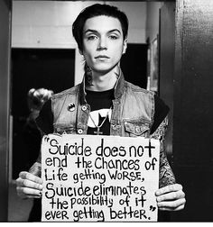 "Andy Biersack holding the ""suicide sign"""