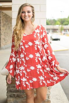 Swing into Fall in this gorgeous brick red, floral swing dress! This flowy…